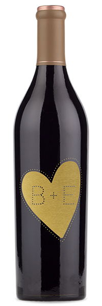 "Red wine bottle etched with initials ""B and E"""