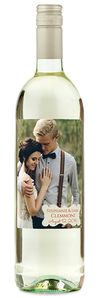 Labeled white wine bottle with photo of soon to be newlyweds.